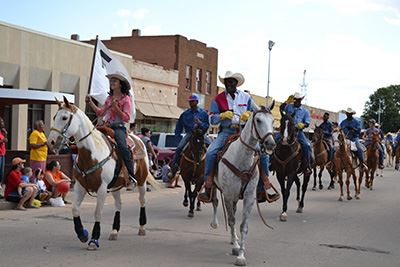 People riding horses during a parade