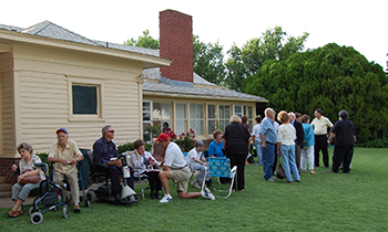 People gather outside the Duggan House Museum