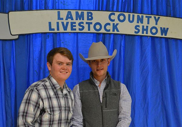 Two young men at the Lamb County Livestock Show
